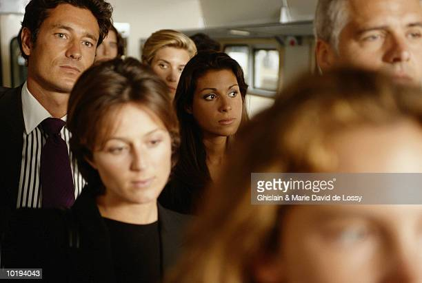 Group of business people on train, close-up