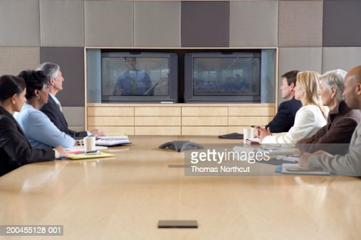 Group of business people participating in video conference, side view : Stock Photo