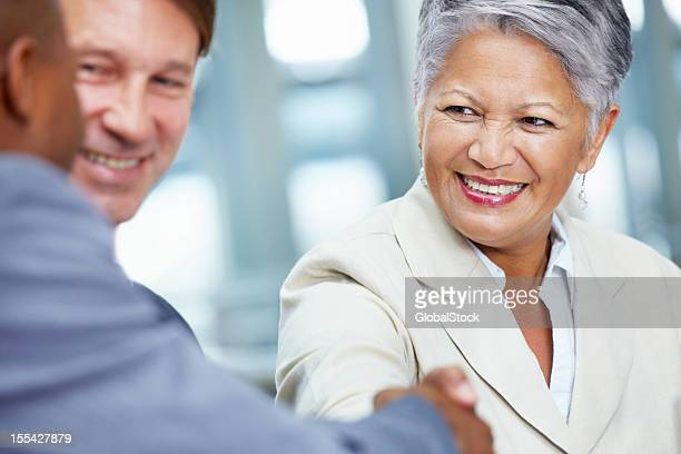 Group of business people shaking hands to meet