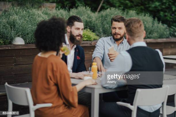 Group of business people sitting by the table and talking