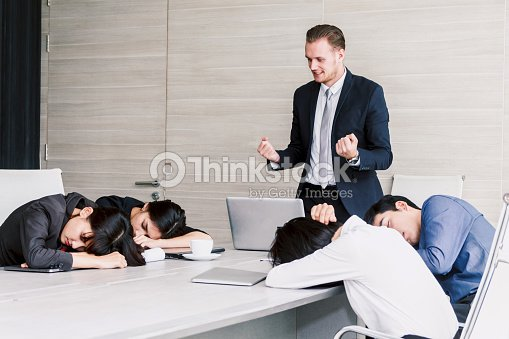 group of business people sleeping at the meeting stock photo