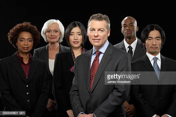 Group of business people, smiling, portrait (digital composite)