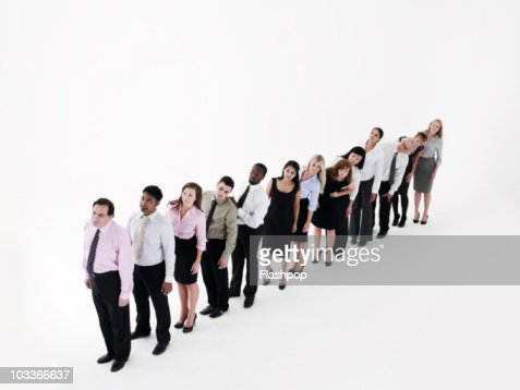 Group of business people standing in a line : Stock Photo