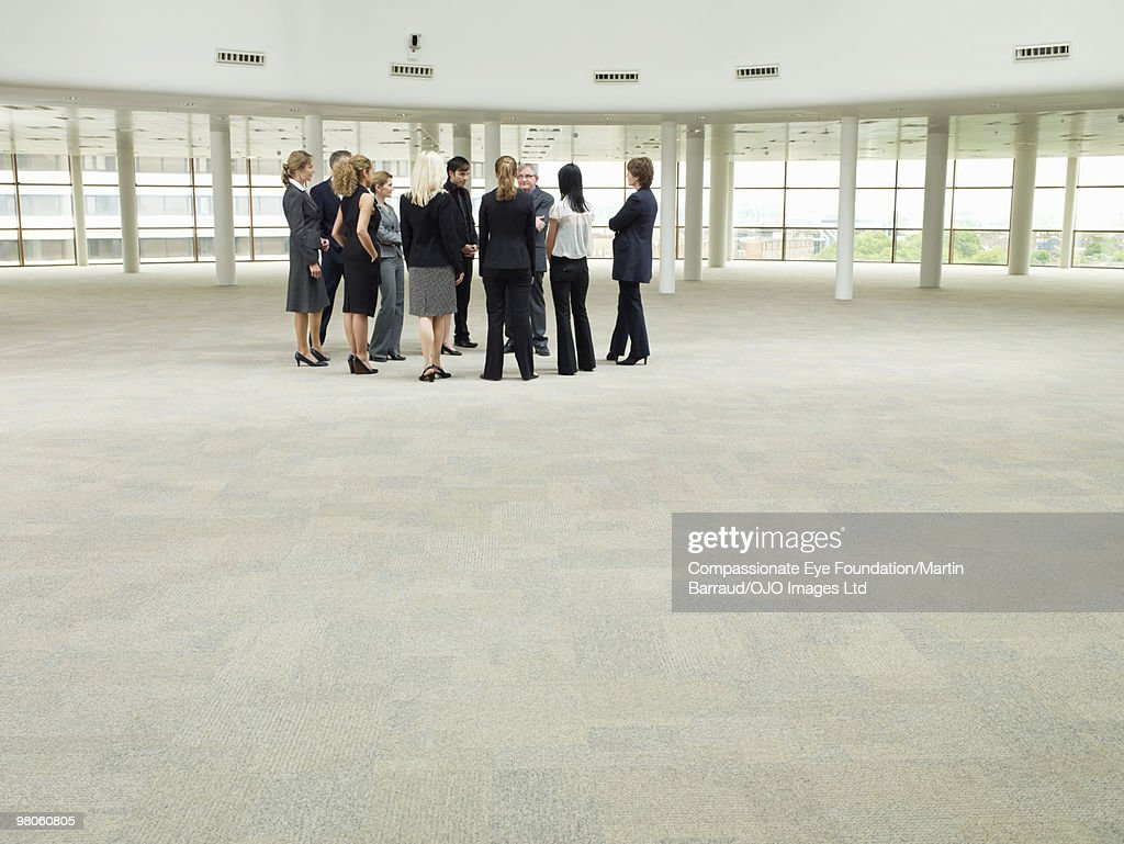 group of business people standing in large room