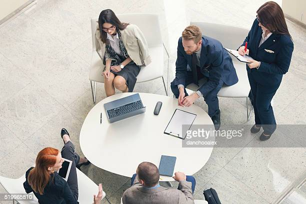 Group of business people talking shot from above