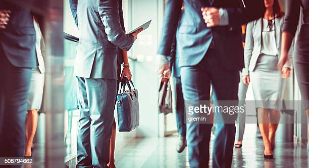 Group of business people walking in the office building lobby