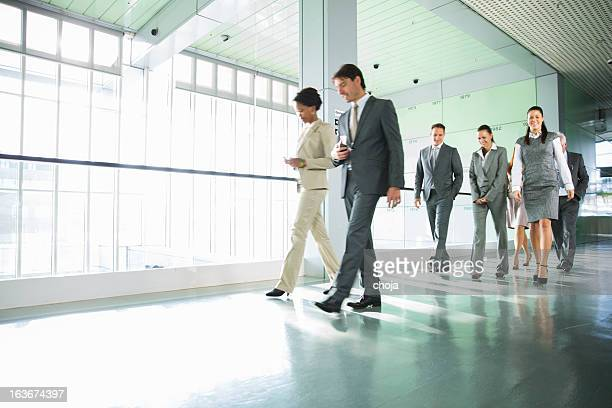 Group of business people walking on corridor