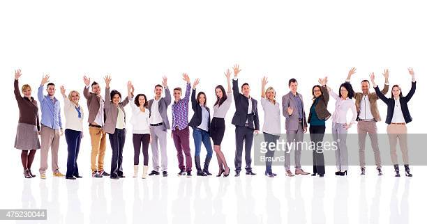 Group of business people waving and looking at camera.