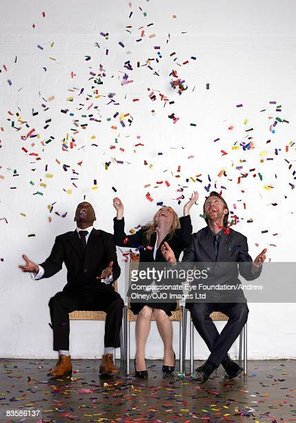 Group of business people with confetti
