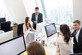 Group of business people working together in headquarters office on high rise buiding in the city