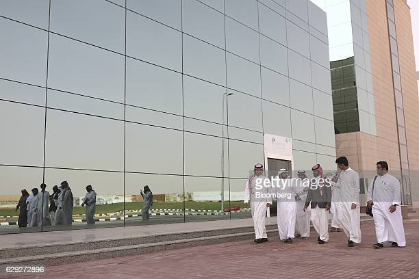 A group of business students walk between buildings on the way to classes at the Sulaiman alRajhi college in Qassim Saudi Arabia on Wednesday Nov 30...