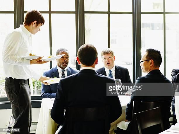 Group of businessmen having meeting in restaurant