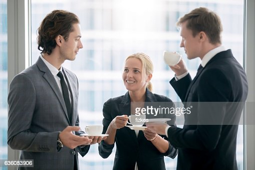 Group of businessmen having tea after meeting : Stock Photo
