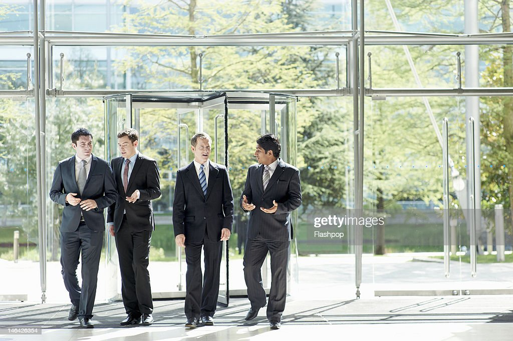 Group of businessmen in discussion : Stock Photo