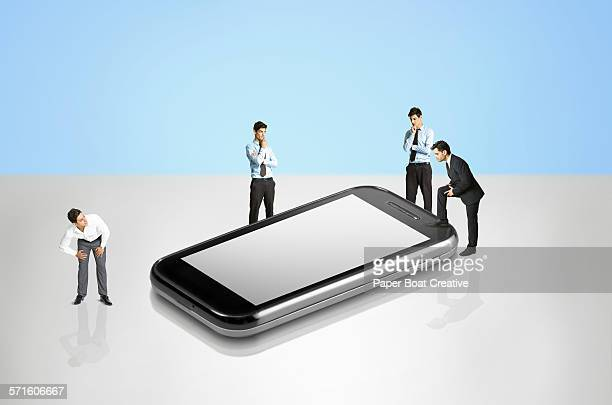 Group of businessmen looking at a