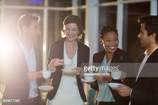 Group of businesspeople having coffee during break : Stock Photo