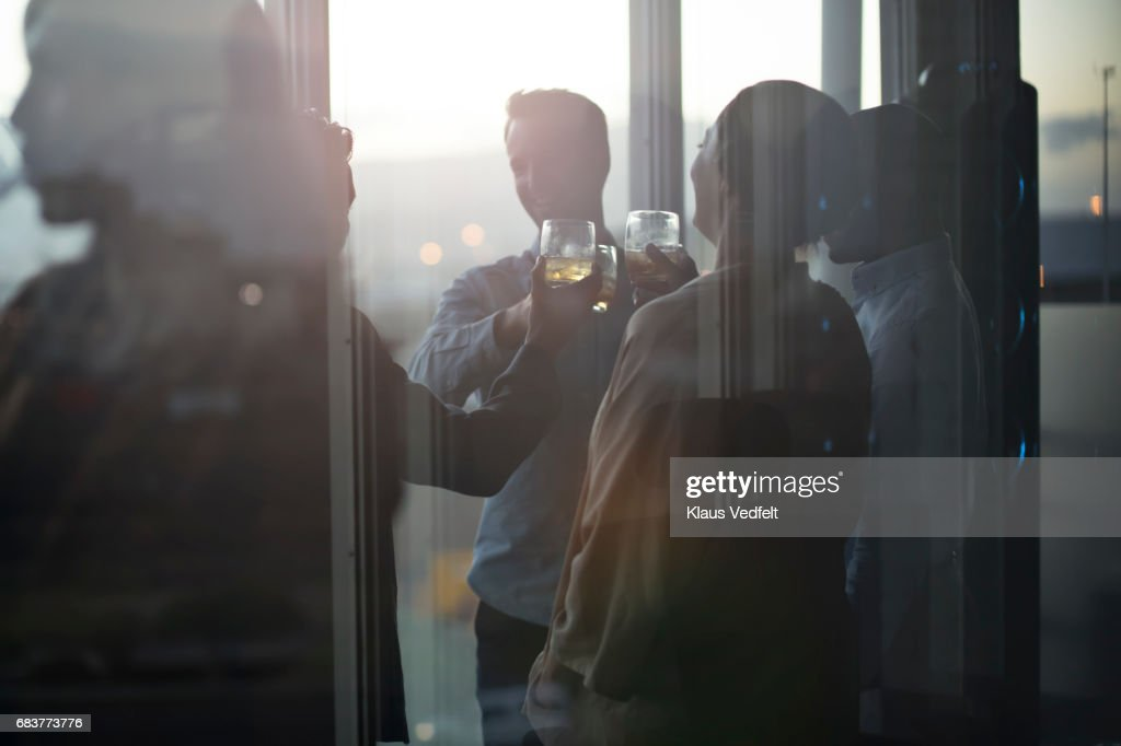 Group of businesspeople having friday night drinks : Stock Photo
