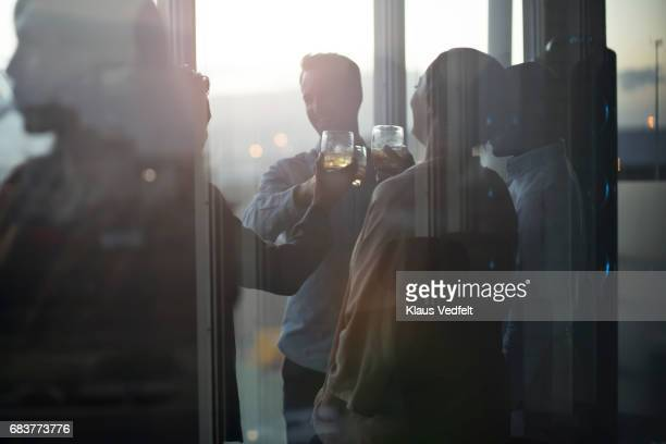 Group of businesspeople having friday night drinks