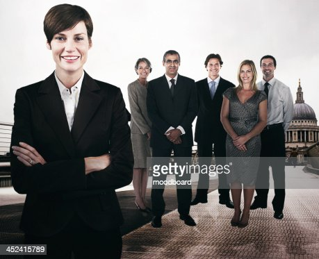 Group of businesspeople on the Millennium Bridge in front of St. Paul's Cathedral : Stock Photo