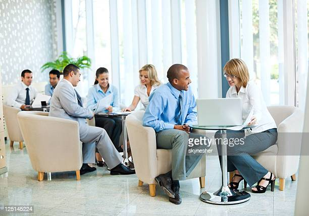 Group of businesspeople sitting and communicating.