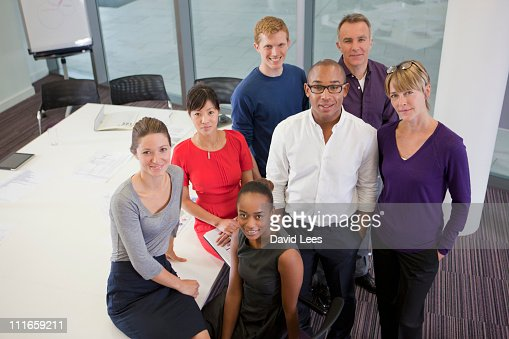 Group of businesspeople, smiling, elevated view : Stock Photo