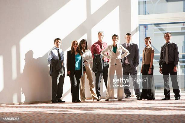 Group of businesspeople standing at large window