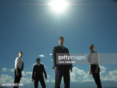 Group of businesspeople standing, low angle view