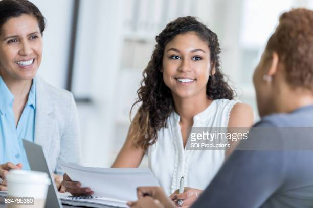 A group of businesswomen have a discussion