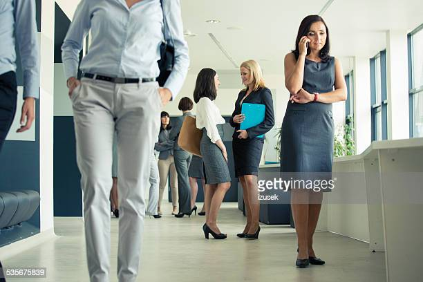Group of businesswomen in an office corridor