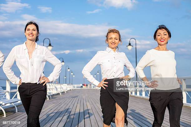 Group of businesswomen walking outdoors