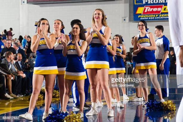 A group of Cal State Bakersfield Roadrunner cheerleaders watch as the 2017 intro video is played during the intros between the New Mexico Aggies and...