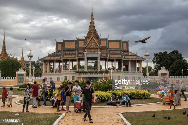 A group of Cambodian street vendors sell their goods to tourists and local people in front of the Royal Palace on August 13 2014 in Phnom Penh...