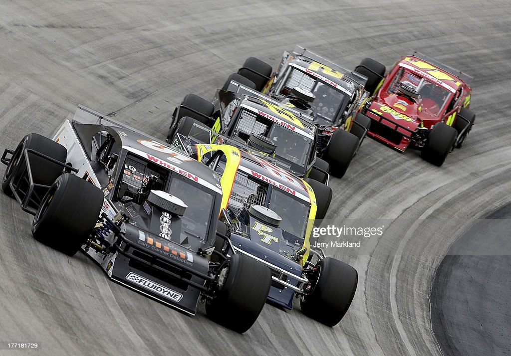 A group of cars race during the NASCAR Whelen Modified Titan Roof 150 at Bristol Motor Speedway on August 21, 2013 in Bristol, Tennessee.