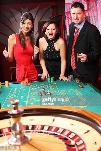 Group of casino gamblers on the roulette.