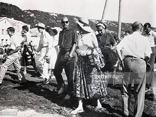 A group of casuallydressed royal visitors come ashore for some sightseeing at the Greek city of Olympia on the second day of the 'Tour of Kings'...