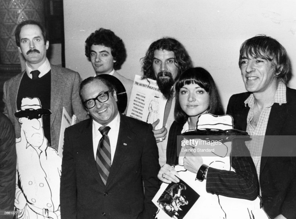 A group of celebrities at the press conference for the Amnesty International charity comedy gala 'The Secret Policeman's Ball'. From left to right, back row: John Cleese, Rowan Atkinson, Billy Connolly, Peter Cook (1937 - 1995) and front row: Clive Jenkins and Anna Ford. Original Publication: People Disc - HF0378