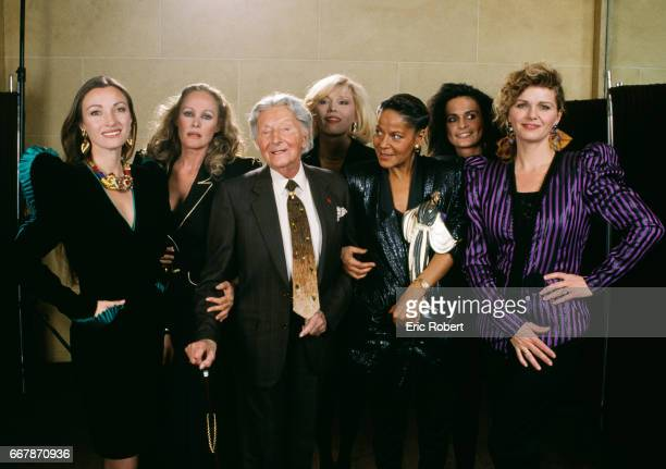 A group of celebrities attend a 1989 Claude Petin fashion show in Paris Left to right are actress Jane Seymour actress Ursula Andress designer Erte...