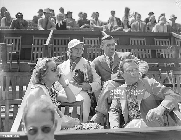 A group of celebrities watches the Beverly Hills Tennis Tournament Actor Clark Gable sits next to tennis player Alice Marble Gable's wife Carole...