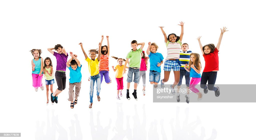 Group of cheerful children jumping with arms raised. : Stock Photo