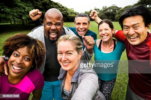 Group of cheerful diverse friends in the park : Stock Photo