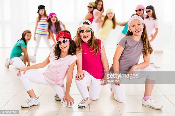 Group of cheerful little hip hop dancers looking at camera.