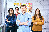 Group of cheerful students looking at camera in classroom. Portrait of young startup entrepreneurs
