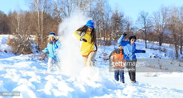 Group of cheerful young skiers having fun in the snow