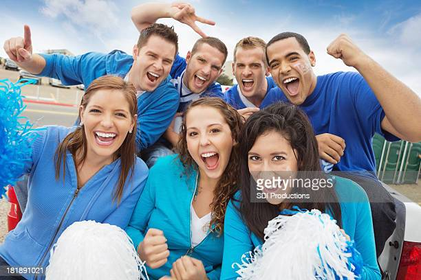 Group of cheering sports fan tailgating at stadium