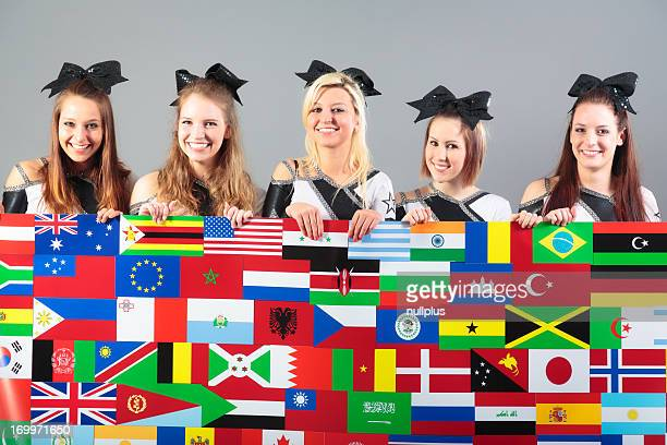 group of cheerleaders holding poster with flags