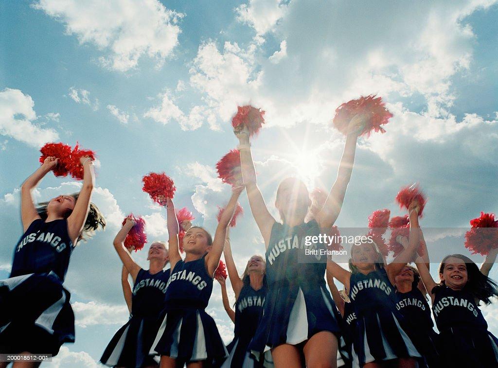 Group of cheerleaders (8-10) jumping, outdoors (Digital Composite)