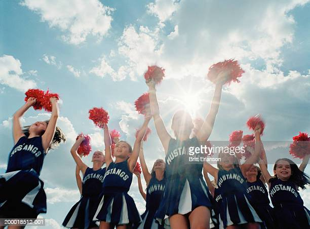 Group of cheerleaders (8-10) jumping, outdoors (Digital Composite)