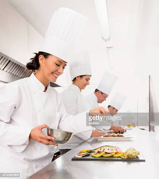 Group of chefs cooking