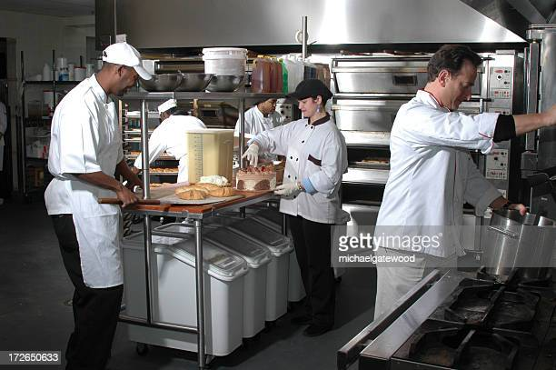 Group of chefs working in kitchen
