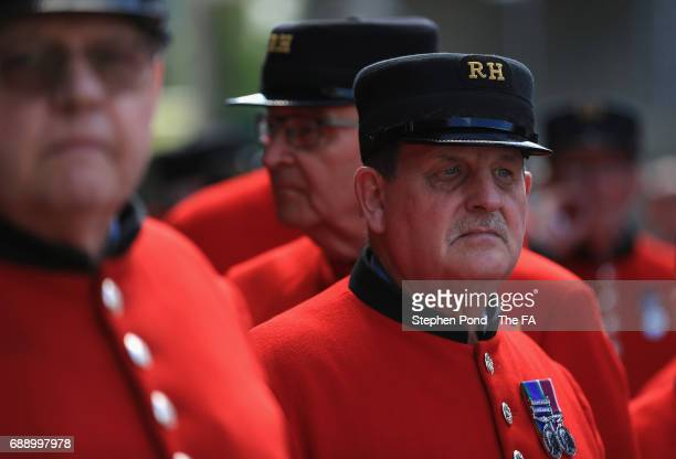 A group of Chelsea Pensioners make their way to the stadium prior to the Emirates FA Cup Final between Arsenal and Chelsea at Wembley Stadium on May...